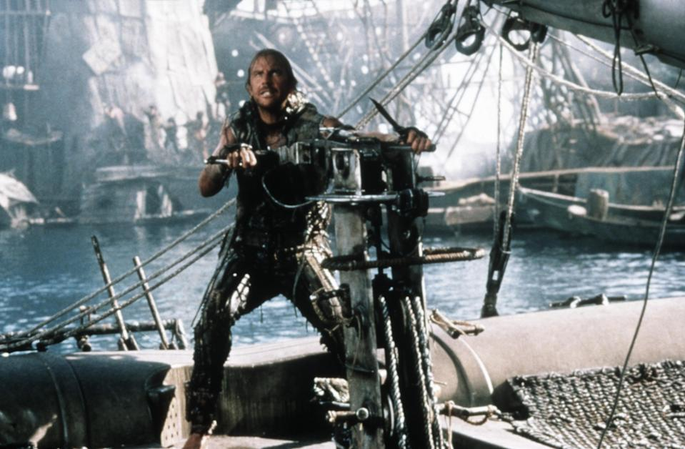 Costner's Mariner on his Trimaran in <em>Waterworld</em>. (Photo: Universal/courtesy Everett Collection)