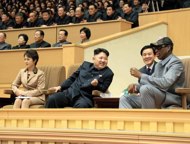 North Korean leader Kim Jong Un watches a basketball game between former U.S. NBA basketball players and North Korean players of the Hwaebul team of the DPRK with Dennis Rodman at Pyongyang Indoor Stadium