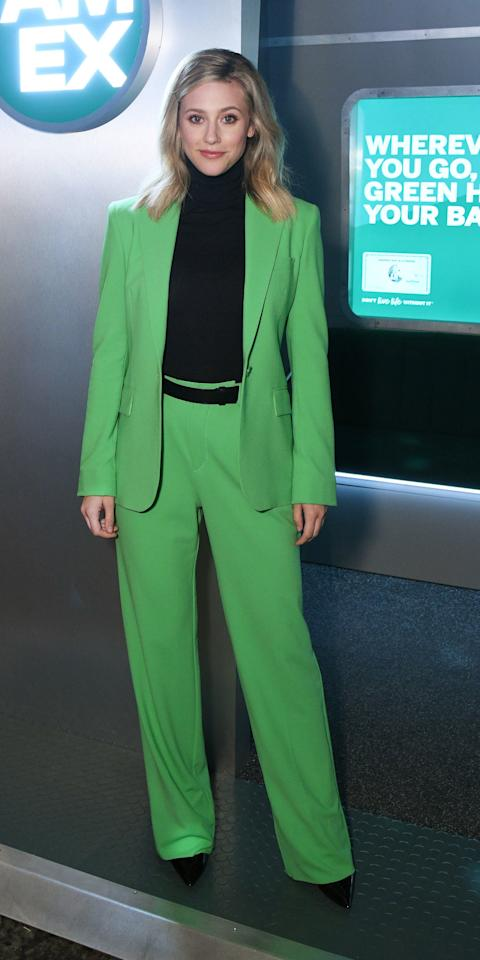 <p>The <em>Riverdale</em> star dressed for the occasion while promoting American Express' new Green Card, showing up in a green Ralph Lauren suit, black turtleneck, a black belt, and black heels.</p>