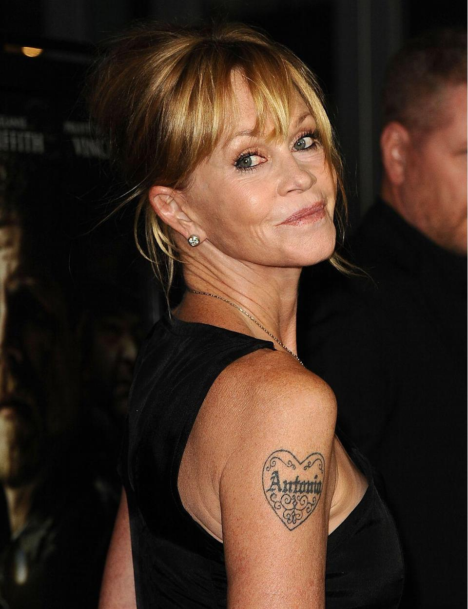 """<p>Melanie Griffith and Antonio Banderas were married for 19 years - which is basically forever in Hollywood years. But fans knew the couple was really over when Melanie appeared on the red carpet with the tattoo of his name on her arm partially covered. At first, the actress used makeup to erase Antonio's name, but the <em><a href=""""https://www.dailymail.co.uk/tvshowbiz/article-3163471/Melanie-Griffith-57-looks-stunning-summery-dress-shows-gone-Antonio-love-heart-tattoo.html"""" rel=""""nofollow noopener"""" target=""""_blank"""" data-ylk=""""slk:Daily Mail"""" class=""""link rapid-noclick-resp"""">Daily Mail</a></em> reports she eventually made the decision to have the ink permanently removed. <br></p>"""