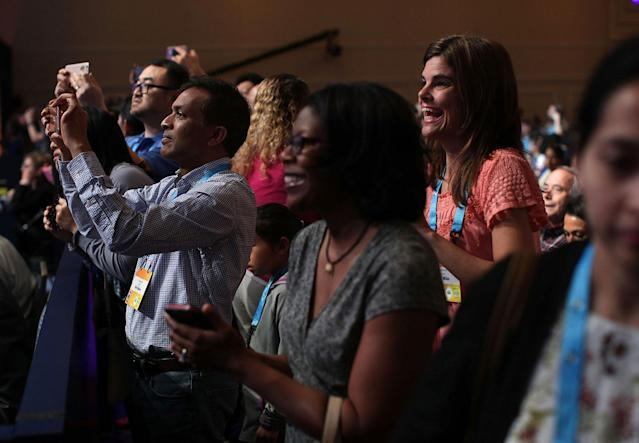 <p>Parents take pictures of their children who are participating onstage in round two of the 2017 Scripps National Spelling Bee at Gaylord National Resort & Convention Center on May 31, 2017. Close to 300 spellers are competing in the annual spelling contest for the top honor this year. (Alex Wong/Getty Images) </p>
