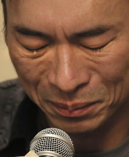 Hong Kong singer Andy Hui attends a press conference about his affair in Hong Kong, Tuesday, April 16, 2019. Hong Kong's Apple Daily newspaper published video that purported to show Andy Hui being intimate in a taxi with another Hong actress, decades younger than him, Jacqueline Wong. (AP Photo/Vincent Yu)