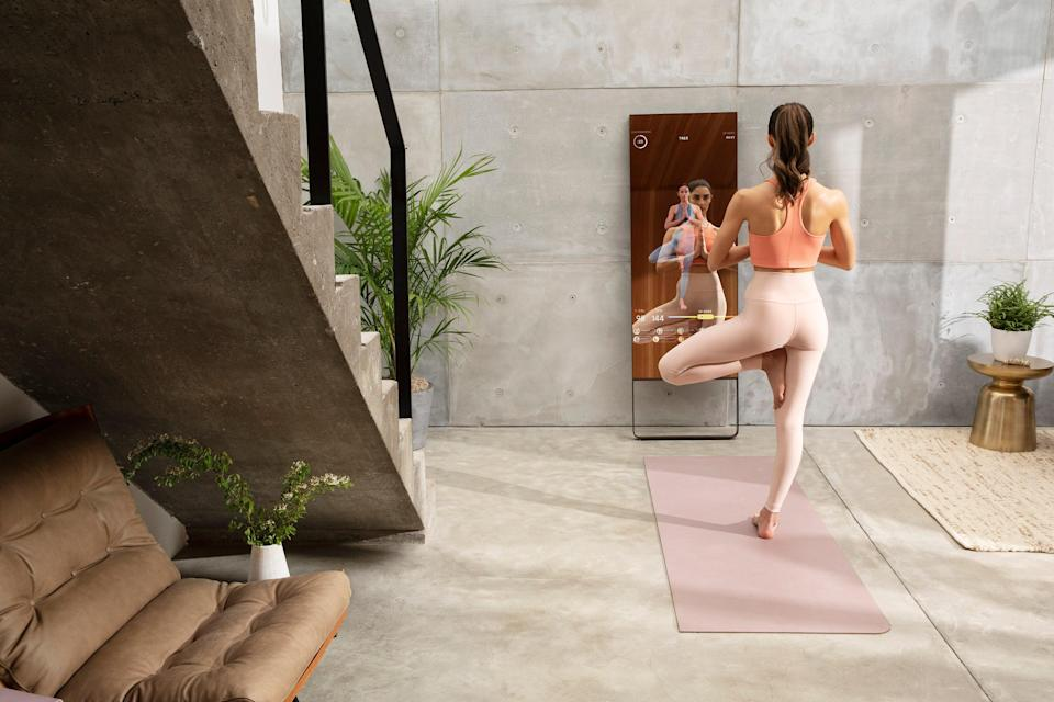"""<h3>Mirror</h3><br><strong>What it is:</strong> A high-tech, <a href=""""https://www.mirror.co/"""" rel=""""nofollow noopener"""" target=""""_blank"""" data-ylk=""""slk:interactive home workout"""" class=""""link rapid-noclick-resp"""">interactive home workout</a> on a reflective screen<br><strong><br>How it works: </strong>Choose from over <a href=""""https://www.mirror.co/workouts"""" rel=""""nofollow noopener"""" target=""""_blank"""" data-ylk=""""slk:10,000 on-demand classes"""" class=""""link rapid-noclick-resp"""">10,000 on-demand classes</a> from top instructors and stream them on your Mirror, from the comfort of your home.<br><strong><br>Price:</strong> $1,495<span class=""""copyright"""">Photo: Courtesy of Mirror</span>"""