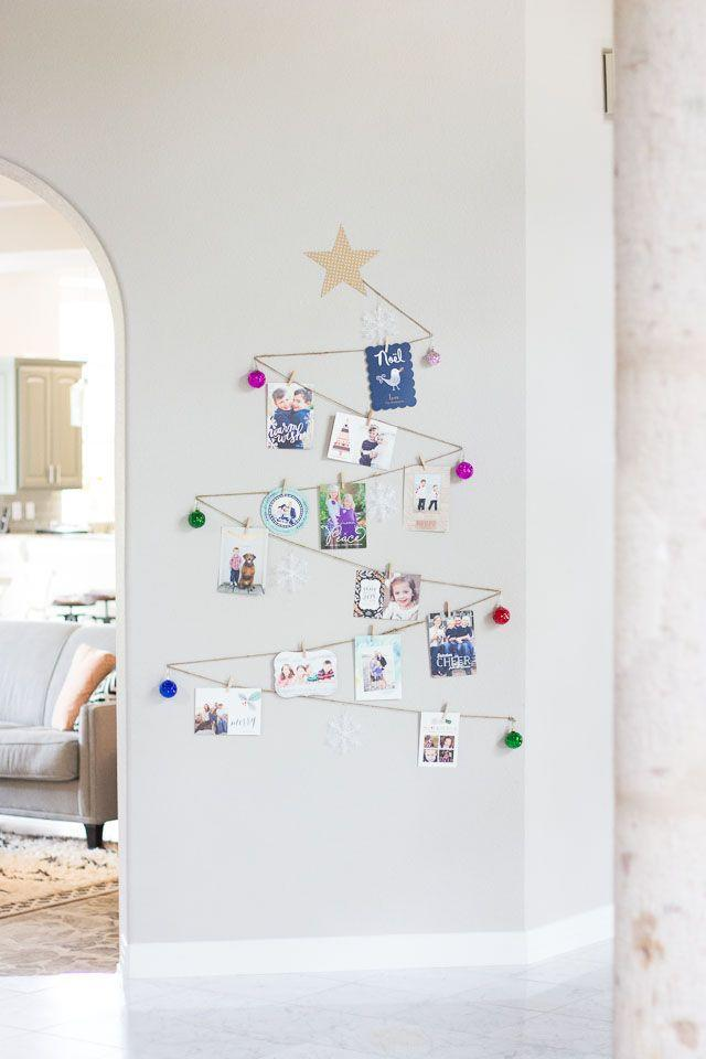 """<p>Arrange your cards on the wall in the shape of a Christmas tree. It's festive and keeps your stack off the counter. </p><p>Get the tutorial at <a href=""""http://www.designimprovised.com/2014/12/simple-diy-holiday-card-display.html"""" rel=""""nofollow noopener"""" target=""""_blank"""" data-ylk=""""slk:Design Improvised"""" class=""""link rapid-noclick-resp"""">Design Improvised</a>.</p>"""