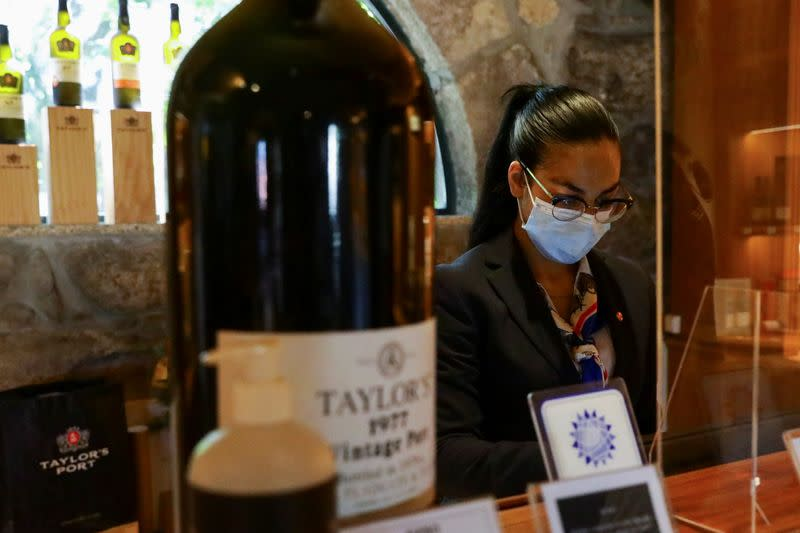 Taylor's Port Wine staff works at the cellars' gift-shop, in Porto