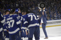 Tampa Bay Lightning head coach Jon Cooper hoists the Stanley Cup after the team defeated the Montreal Canadiens in Game 5 of the NHL hockey Stanley Cup finals, Wednesday, July 7, 2021, in Tampa, Fla. (AP Photo/Phelan Ebenhack)