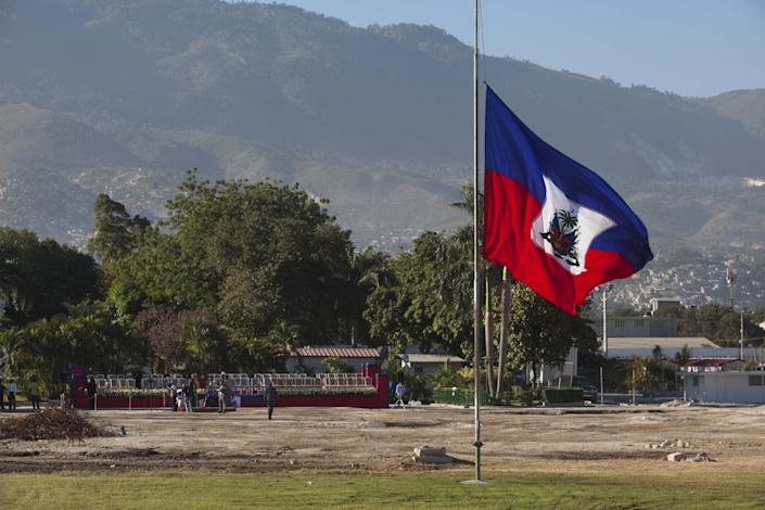 A Haitian national flag flies at half-mast on the front lawn of the former National Palace, marking the 3rd anniversary of the devastating 7.0 magnitude earthquake, in Port-au-Prince, Haiti, Saturday, Jan. 12, 2013. Clad in black, several dozen senior government officials gathered where the elegant white palace had stood before it collapsed in the temblor and was later demolished. Most of the rubble created by the quake has since been carted away but more than 350,000 people still live in grim displacement camps. (AP Photo/Dieu Nalio Chery)
