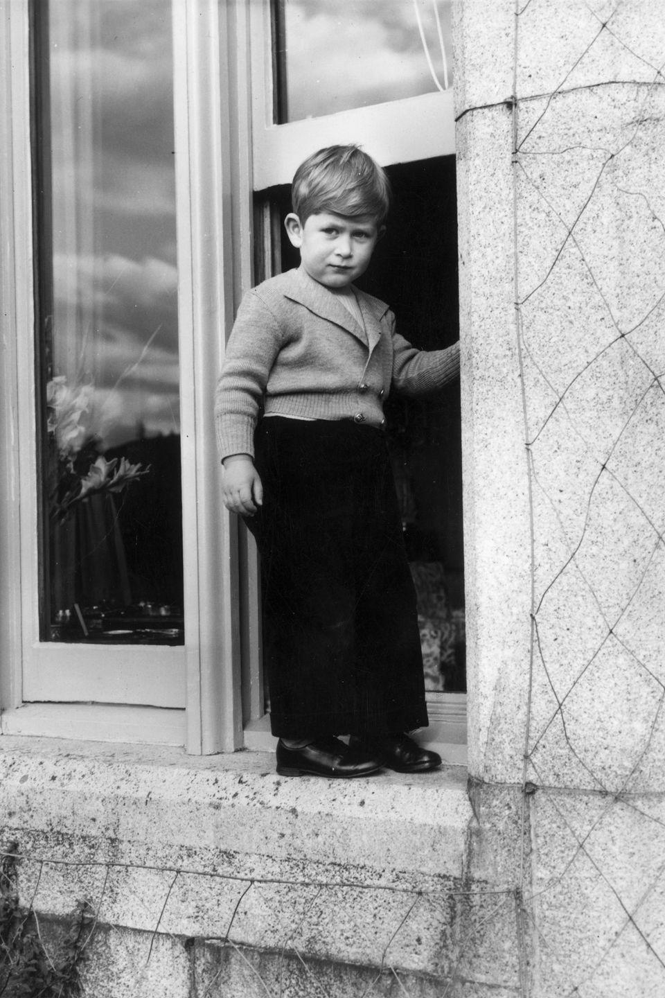 <p>Posing for a photo as a toddler at Balmoral Castle in Scotland. </p>