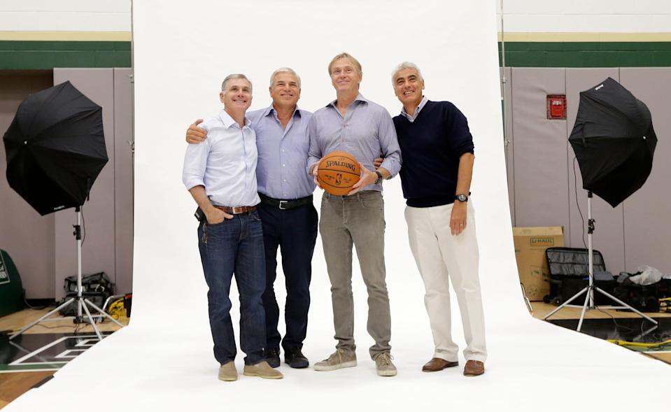 The Bucks ownership group led by Wes Edens (second from right) and Marc Lasry (far right) invested resources to help build a championship team.