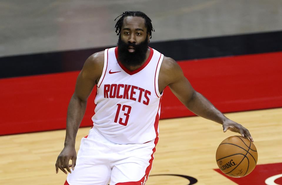 James Harden controls the ball during a game with the Rockets.