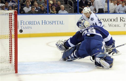 Toronto Maple Leafs center Mikhail Grabovski, of Germany, (84) shoots and scores a goal against Tampa Bay Lightning goalie Anders Lindback, of Sweden, (39) during the first period of an NHL hockey game Tuesday, Feb. 19, 2013, in Tampa, Fla. (AP Photo/Brian Blanco)