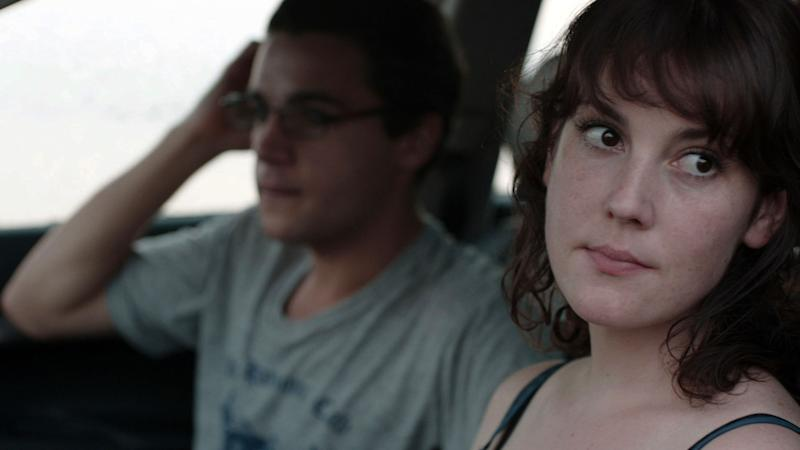 """This film image released by Oscilloscope Laboratories shows Christopher Abbott, left, and Melanie Lynskey in a scene from """"Hello I Must Be Going."""" (AP Photo/Oscilloscope Laboratories)"""