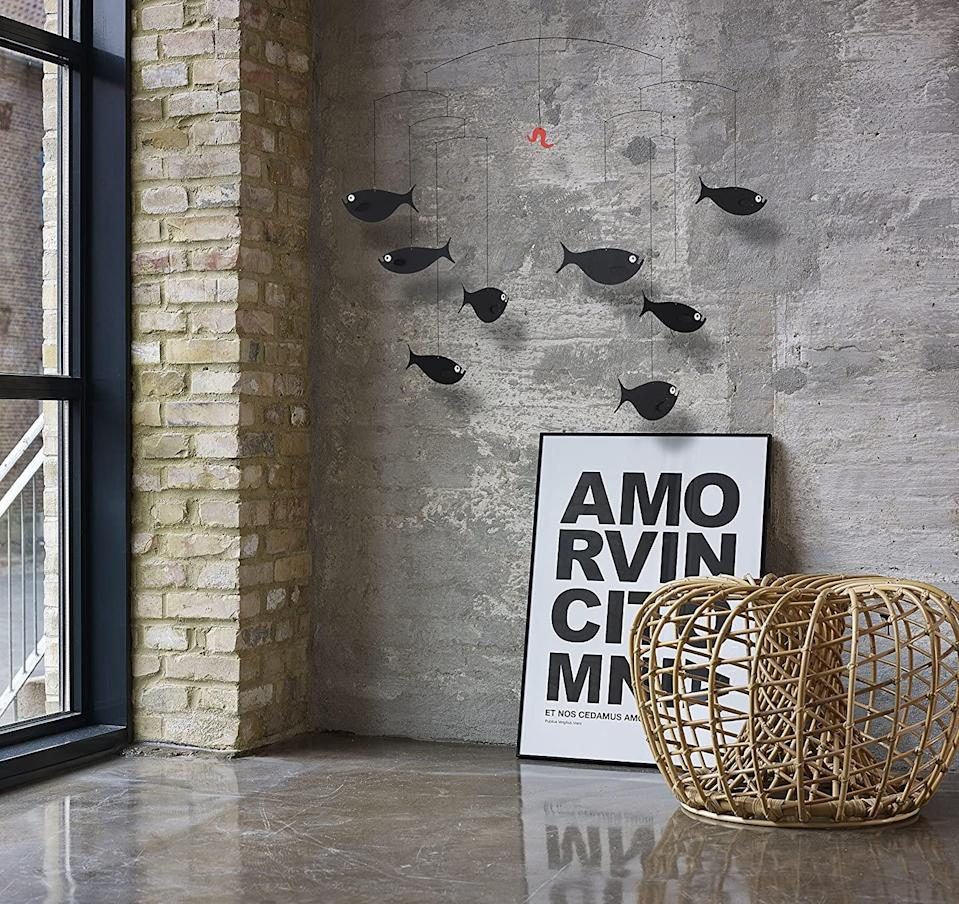 """<h2>Flensted Mobile Shoal of Fishes Mobile</h2><br>This chic, Danish-designed would add minimal flair to any room, from a nursery to a living room.<br><br><strong>Flensted Mobiles</strong> Shoal of Fishes Mobile, $, available at <a href=""""https://www.amazon.com/dp/B000W48ZJW"""" rel=""""nofollow noopener"""" target=""""_blank"""" data-ylk=""""slk:Amazon"""" class=""""link rapid-noclick-resp"""">Amazon</a>"""