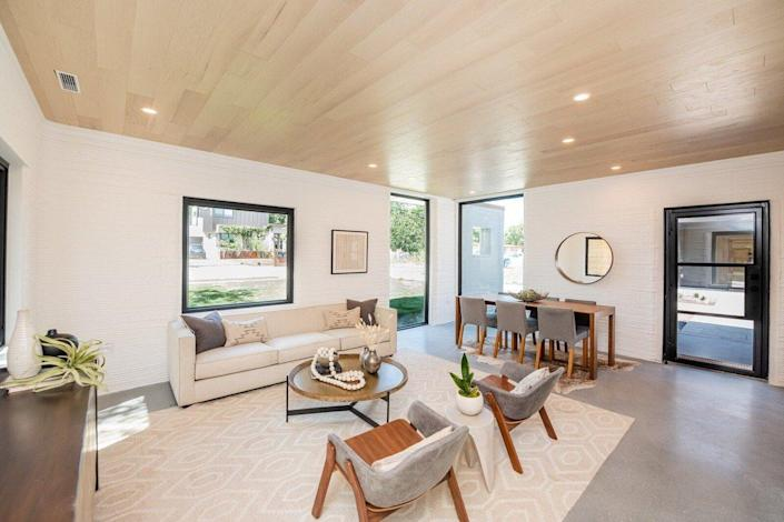 Simple and bright living space inside the 3D printed homes of Logan Architecture and ICON in Austin.