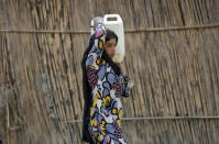 A girl carries a jerrycan filled with drinking water in a slum area on a hot summer day in New Delhi, India, April 27, 2016. REUTERS/Anindito Mukherjee
