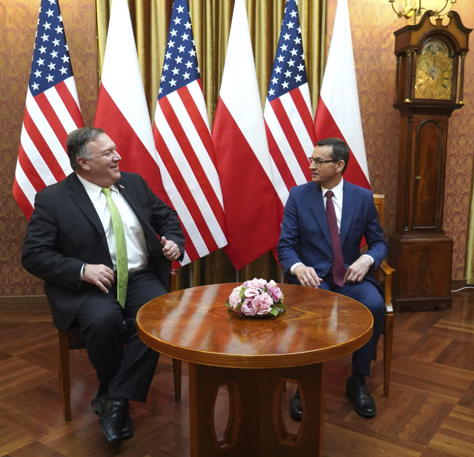 US Secretary of State Mike Pompeo, left, talks with Poland's Prime Minister Mateusz Morawiecki prior to a meeting at the Chancellery in Warsaw, Poland, Saturday Aug. 15, 2020. Pompeo is on a five day visit to central Europe. (Janek Skarzynski/Pool via AP)