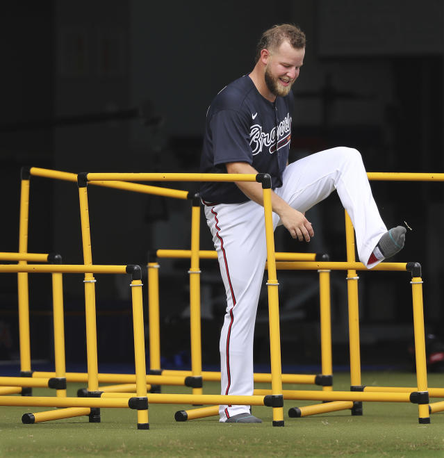 Atlanta Braves pitcher A.J. Minter does an agility drill at baseball spring training practice in North Port, Fla., Friday, Feb. 14, 2020. (Curtis Compton/Atlanta Journal-Constitution via AP)
