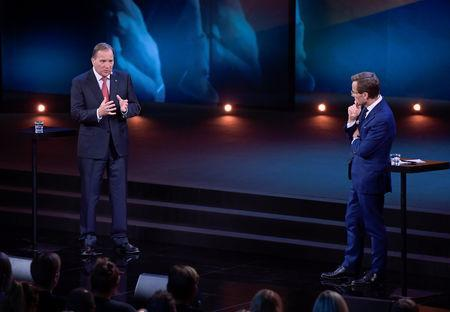 Ulf Kristersson, leader of the Moderate Party and Stefan Lofven, leader of the Social Democratic Party during a party duel broadcast by Sweden's tv-channel TV4 from Linkoping, Sweden September 8, 2018. TT News Agency/Anders Wiklund/via REUTERS