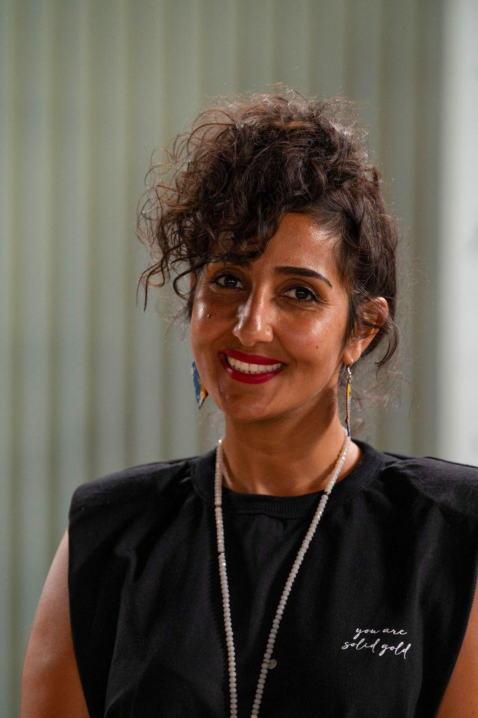 """<p>Film set designer Mona who lives in Brixton, London, says lockdown was the perfect time for her to be on the show, as it meant she had more time on her hands. </p><p><strong>Q:</strong> Which <a href=""""https://www.housebeautiful.com/uk/decorate/a34943483/interior-trends-ranked/"""" rel=""""nofollow noopener"""" target=""""_blank"""" data-ylk=""""slk:interior"""" class=""""link rapid-noclick-resp"""">interior</a> designers is your style most like?</p><p><strong>A:</strong> 'A strong Scandinavian style with the right balance of shabby chic, rustic elements, contemporary touch, industrial kiss, bohemian flowers, traditional love and Bauhaus obsession is my signature style. I couldn't say there is a specific designer which I believe my style is most like, as I love so many designers. I would call my style tasteful and I believe my happy and colourful personality is mirrored in it.'</p>"""