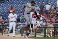 Washington Nationals Juan Soto (22) is safe at first as Pittsburgh Pirates second baseman Erik Gonzalez (2) reaches for the tag during the first inning of a baseball game, Monday, June 14, 2021, in Washington. The call on the field was out but was overturned after a review. (AP Photo/Carolyn Kaster)