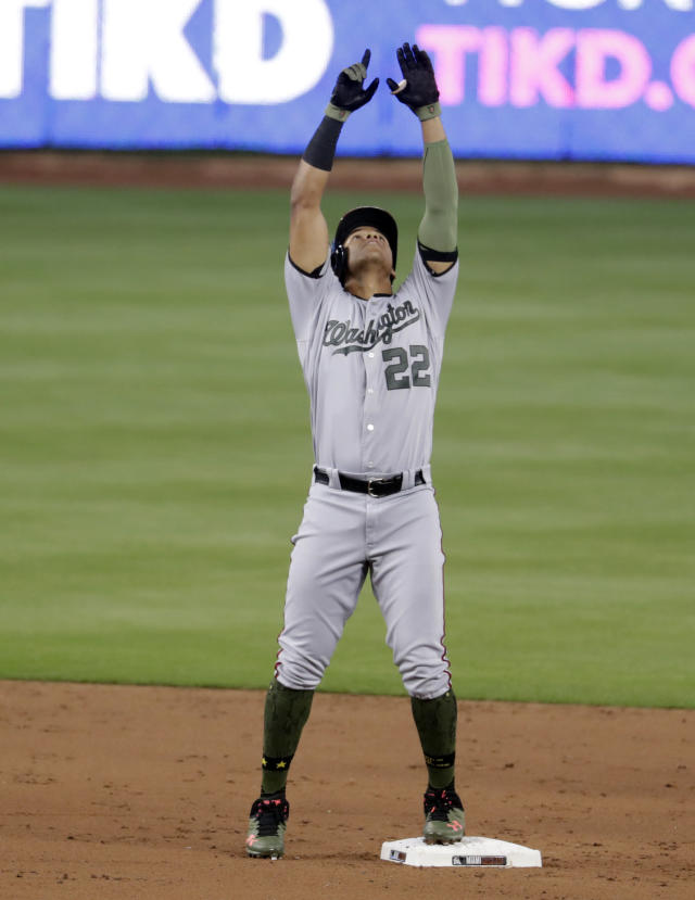 Washington Nationals' Juan Soto gestures after hitting a double during the second inning of a baseball game against the Miami Marlins, Saturday, May 26, 2018, in Miami. (AP Photo/Lynne Sladky)