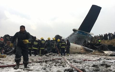 The plane was carrying 67 passengers when it crashed on landing - Credit:  Niranjan Shreshta/ AP