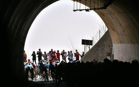 <span>Riders pass through the Turchino tunnel </span> <span>Credit: Getty Images </span>