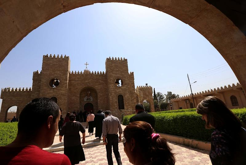 Iraqi Christians head to Saint Joseph church in Arbil on August 6, 2015, during a rally marking the frist anniversary of an Islamic State group offensive on Christian-populated areas in the Nineveh province (AFP Photo/Safin Hamed)