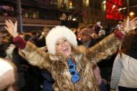 A reveller takes part in the Hogmanay (New Year) street party celebrations in Edinburgh, Scotland, January 1, 2014. REUTERS/Russell Cheyne