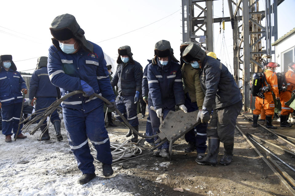 In this photo released by China's Xinhua News Agency, rescuers work at the site of a gold mine that suffered an explosion in Qixia in eastern China's Shandong Province, Tuesday, Jan. 12, 2021. Authorities have detained managers at a gold mine in eastern China where more than 20 workers have been trapped underground following an explosion Sunday. (Wang Kai/Xinhua via AP)
