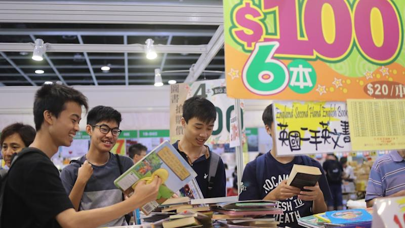 Hong Kong Book Fair draws readers looking for banned books, fans and bargain hunters despite the gloomy weather