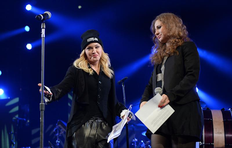 """Madonna, left, introduces Maria """"Masha"""" Alekhina of Pussy Riot to the stage Amnesty International's """"Bringing Human Rights Home"""" concert at the Barclays Center on Wednesday, Feb. 5, 2014 in New York. (Photo by Evan Agostini/Invision/AP)"""