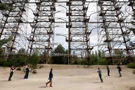 "Visitors inspect constructions of a former Soviet Union over-the-horizon (OTH) radar system ""Duga"" near the Chernobyl Nuclear Power Plant, near Chernobyl"