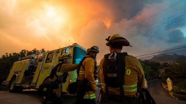 PHOTO: Firefighters from the Governors Office of Emergency Services monitor the advance of smoke and flames from the Thomas Fire, Dec. 16, 2017 in Montecito, Calif. (Robyn Beck/AFP/Getty Images)