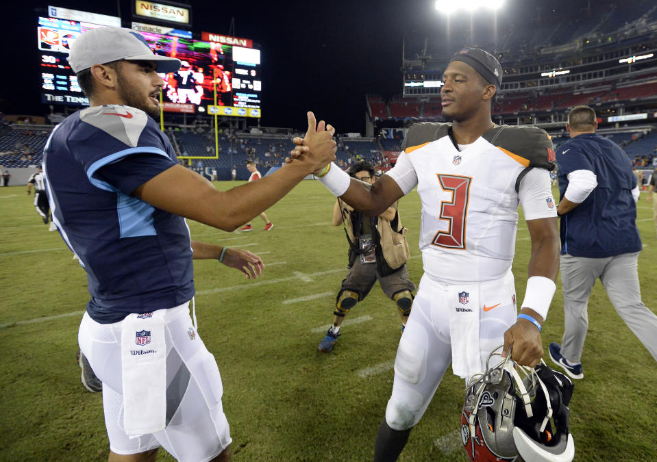 Tennessee Titans quarterback Marcus Mariota, left, shakes hands with Tampa Bay Buccaneers quarterback Jameis Winston (3) after a preseason NFL football game Saturday, Aug. 18, 2018, in Nashville, Tenn. The Buccaneers won 30-14. (AP Photo/Mark Zaleski)