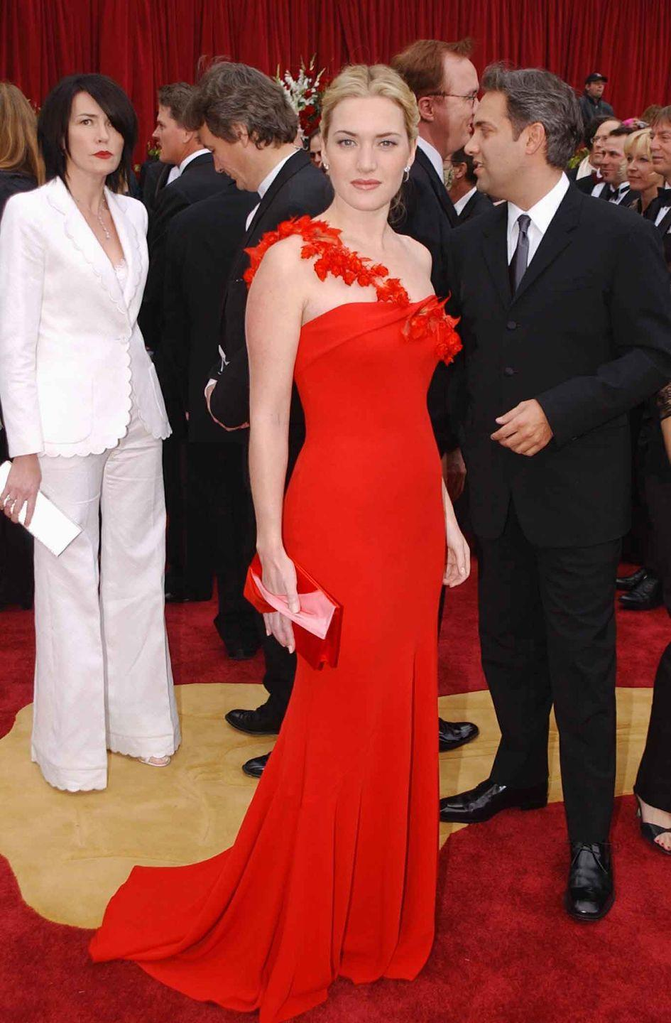 <p>Kate Winslet in a one-shoulder red Ben de Lisi gown.</p>