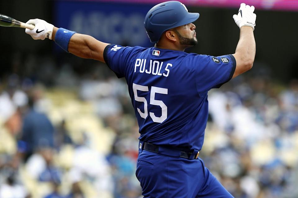 The Dodgers' Albert Pujols follows through after hitting a solo home run against the New York Mets.