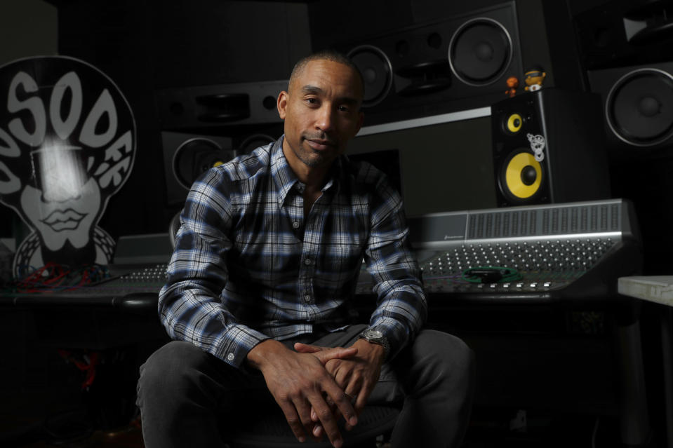 """Singer-songwriter Johnta Austin poses for a photograph Friday, Dec. 20, 2019, in Atlanta to promote his album """"Love, Sex & Religion."""" Austin has two Grammy Awards and has co-written a handful of other multi-platinum hits deemed R&B classics, including Mariah Carey's """"We Belong Together"""" and Mary J. Blige's """"Be Without You."""" (AP Photo/John Bazemore)"""