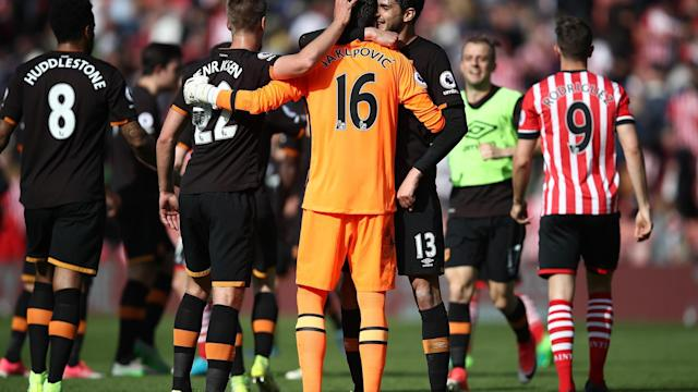 <p>Hull City's Eldin Jakupovic celebrates at the end of the match with team mates </p>