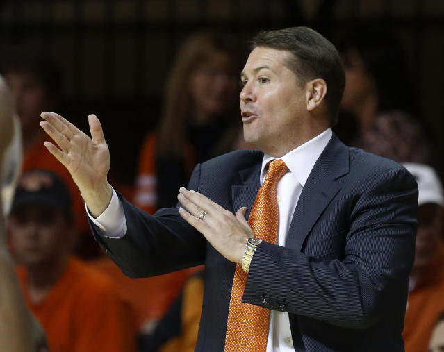 Oklahoma State coach Travis Ford gestures to his team in the first half of an NCAA college basketball game against Mississippi Valley State in Stillwater, Okla., Friday, Nov. 8, 2013. Oklahoma State won 117-62. (AP Photo/Sue Ogrocki)