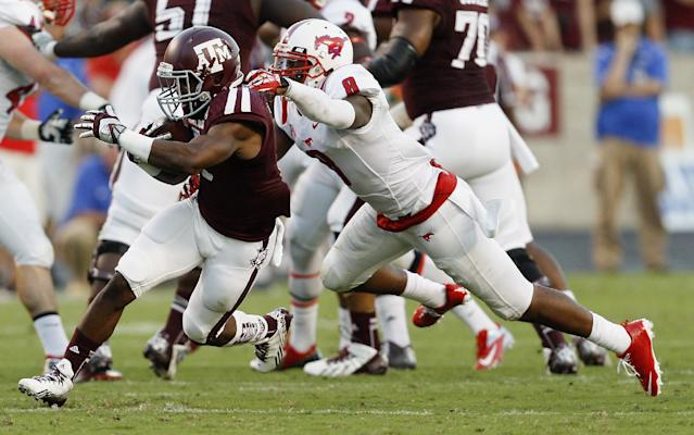 Texas A&M running back Ben Malena (1) is tackled by SMU defensive back Jay Scott (8) during the second quarter of an NCAA college football game Saturday, Sept. 21, 2013, in College Station, Texas. (AP Photo/Bob Levey)