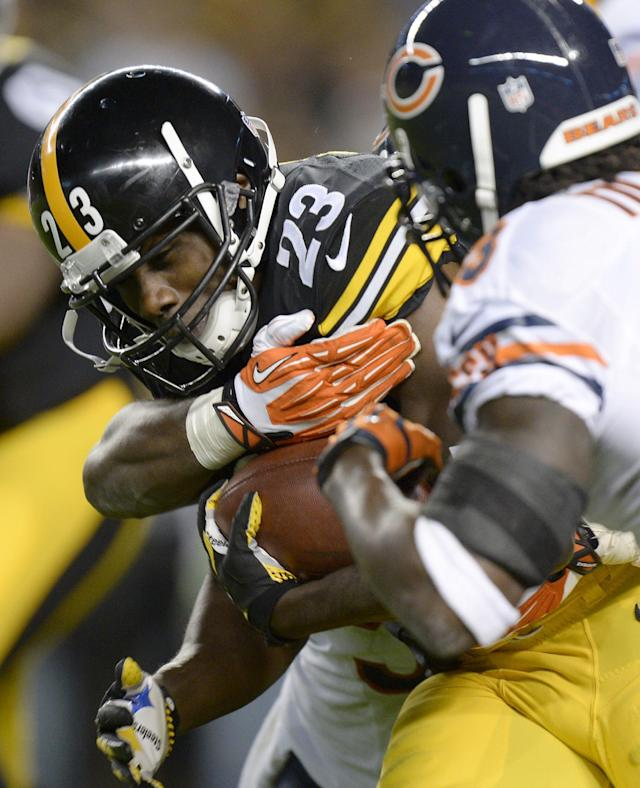 Pittsburgh Steelers running back Felix Jones (23) tries to run past Chicago Bears cornerback Charles Tillman, right, in the second quarter of an NFL football game on Sunday, Sept. 22, 2013, in Pittsburgh. (AP Photo/Don Wright)