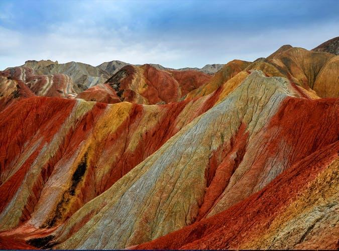 <p>No, these mountains haven't been spray-painted. They're made up of layers of different-colored sandstone and minerals that have been pressed together for over 24 million years.</p>