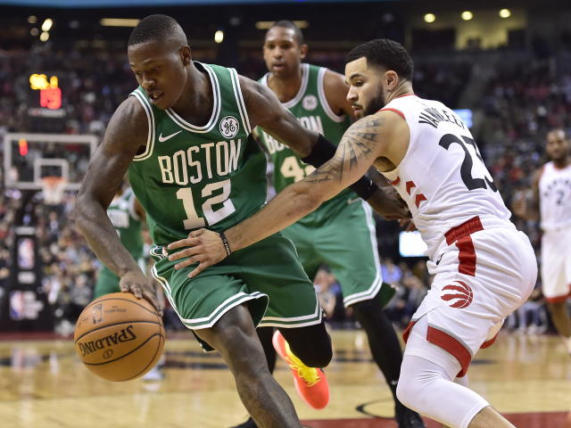 Boston Celtics guard Terry Rozier (12) moves past Toronto Raptors guard Fred VanVleet (23) during second-half NBA basketball game action in Toronto, Friday, Oct. 19, 2018. (Frank Gunn/The Canadian Press via AP)