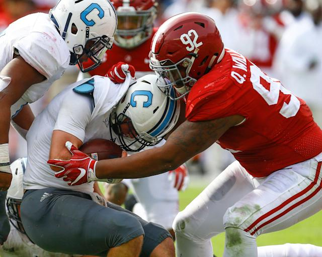 Citadel quarterback Brandon Rainey is stopped by Alabama defensive lineman Quinnen Williams. (AP Photo)