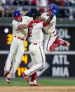 Philadelphia Phillies' Travis Jankowski, left, Jean Segura (2) and Ronald Torreyes, right, celebrate after the Phillies defeated the New York Yankees 8-7 in 10 innings in a baseball game Saturday, June 12, 2021, in Philadelphia. (AP Photo/Laurence Kesterson)