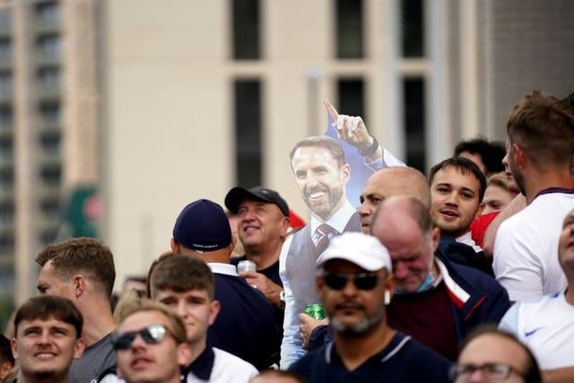 England fans with a cut-out of Gareth Southgate outside Wembley