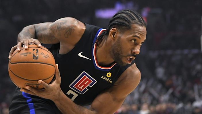 Los Angeles Clippers forward Kawhi Leonard moves toward the basket during the second half of an NBA basketball game against the Denver Nuggets Friday, Feb. 28, 2020, in Los Angeles. The Clippers won 132-103. (AP Photo/Mark J. Terrill)