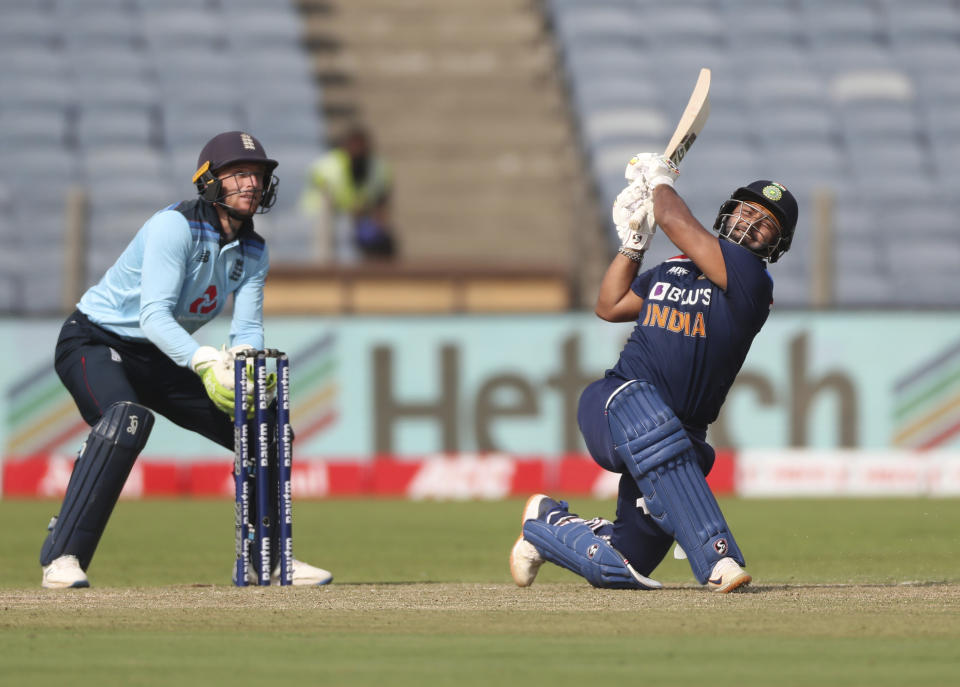 India's Rishabh Pant, right, plays a shot during the second One Day International cricket match between India and England at Maharashtra Cricket Association Stadium in Pune, India, Friday, March 26, 2021. (AP Photo/Rafiq Maqbool)