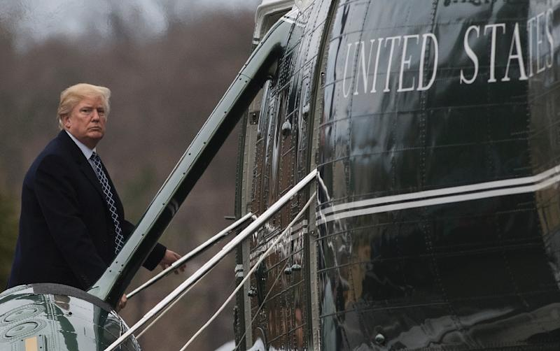 Donald Trump -- shown here on Friday heading for his first presidential physical -- lashed out at immigrants from certain countries, using profanity, several newspapers report (AFP Photo/SAUL LOEB)